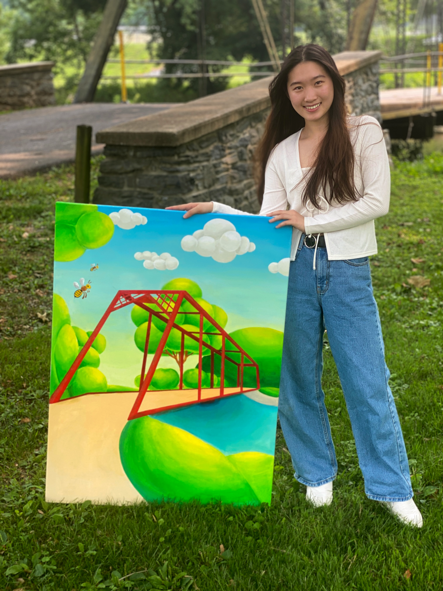 student near bridge with her bright colored bridge painting