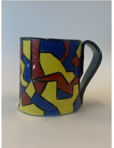 ceramic mug with bright colored lines